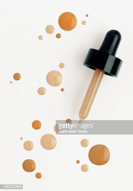 dropper and multi colored dots of make-up foundation - for sale stock pictures, royalty-free photos & images