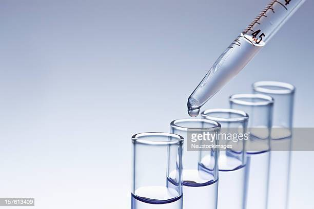 dropper filling test tubes - vial stock pictures, royalty-free photos & images