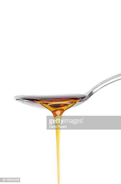 dropping honey from spoon - syrup stock pictures, royalty-free photos & images