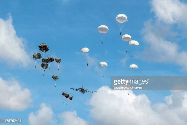 dropping of paratroopers by a hercules airplane at the occasion of the 75th anniversary of operation market garden during world war ii - nijmegen stock pictures, royalty-free photos & images
