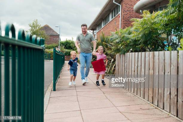 dropping the kids off - education stock pictures, royalty-free photos & images