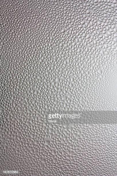 グレイの水ドロップ、創造的な抽象的なデザインの背景の写真