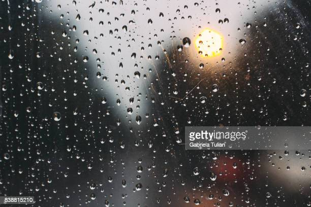 drops of rain on glass - weather stock pictures, royalty-free photos & images