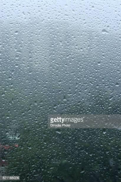 drops of rain water on window glass borivali mumbai maharashtra india asia - monsoon stock pictures, royalty-free photos & images