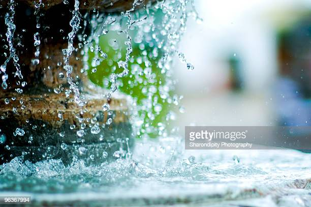 drops of water from fountain - fountain stock pictures, royalty-free photos & images