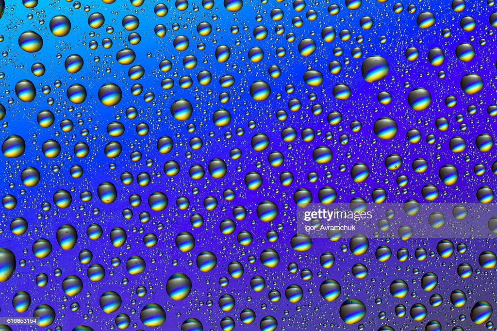 Drops of water on a colorful background : Stock Photo