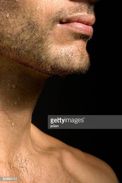 drops of water on man's lips and neck, close-up  - stoppelbart stock-fotos und bilder