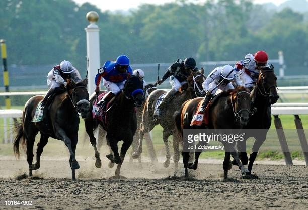 Drosselmeyer with Mike Smith aboard leads down the backstretch to win the 142nd Running of the Belmont Stakes at Belmont Park on June 5 2010 in...