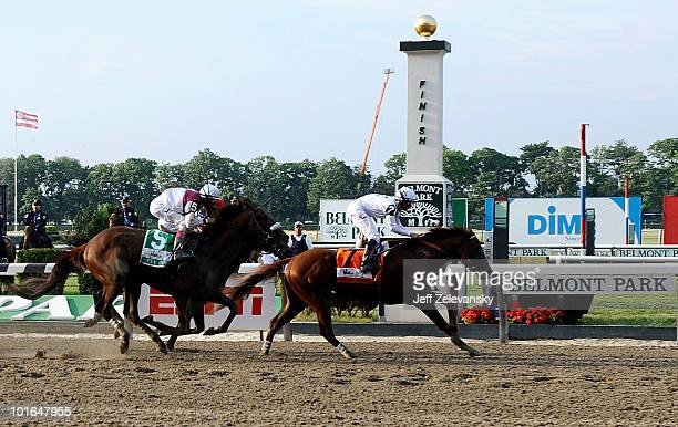 Drosselmeyer with Mike Smith aboard wins the 142nd Running of the Belmont Stakes in front of Fly Down with John Velazquez aboard at Belmont Park on...