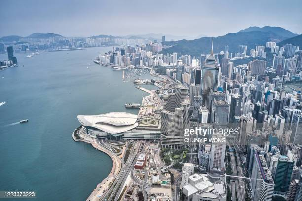 drove view of high-rise buildings in hong kong - hong kong stock pictures, royalty-free photos & images