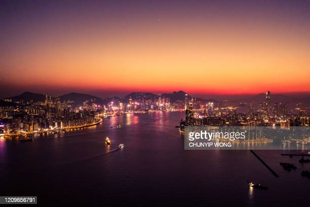drove view of victoria harbour, hong kong - hong kong stock pictures, royalty-free photos & images