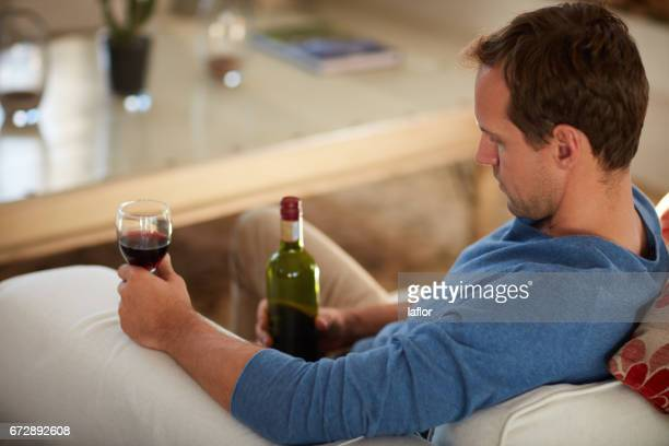 drowning his sorrows away - alcohol abuse stock photos and pictures