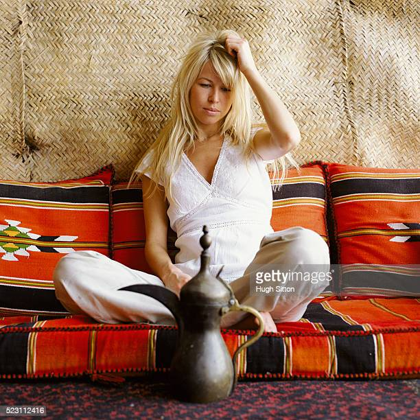 drowsy woman in a tent with cushions - hugh sitton stock pictures, royalty-free photos & images