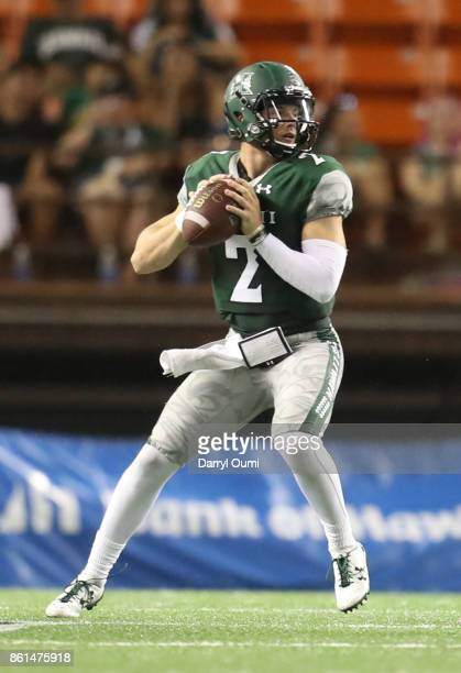 Dru Brown of the Hawaii Rainbow Warriors looks for a receiver downfield during the second quarter of the game against the San Jose State Spartans at...