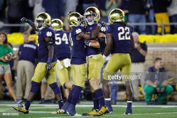 Drue Tranquill of the Notre Dame Fighting Irish celebrates with teammates after recovering a fumbled punt in the second quarter of a game against the...