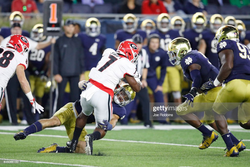 Drue Tranquill #23 of the Notre Dame Fighting Irish makes a tackle against D'Andre Swift #7 of the Georgia Bulldogs in the second quarter of a game at Notre Dame Stadium on September 9, 2017 in South Bend, Indiana.