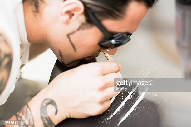 Drug Abuse Young man doing Cocaine