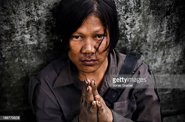 Drug addict begging in a Bangkok park