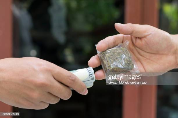 Drug addict buying narcotics and paying