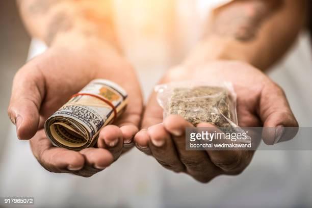 drug addict buying narcotics and paying - marijuana money stock photos and pictures