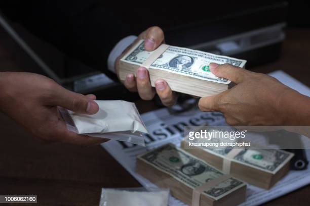 drug addict buying narcotics and paying,heroin - trafficking stock photos and pictures