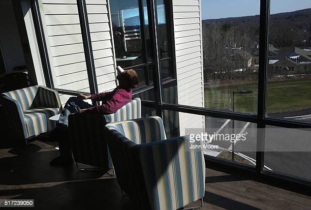 A drug addict in recovery drains the last drops of a yogurt drink at a substance abuse treatment center on March 22 2016 in Westborough MA The new...