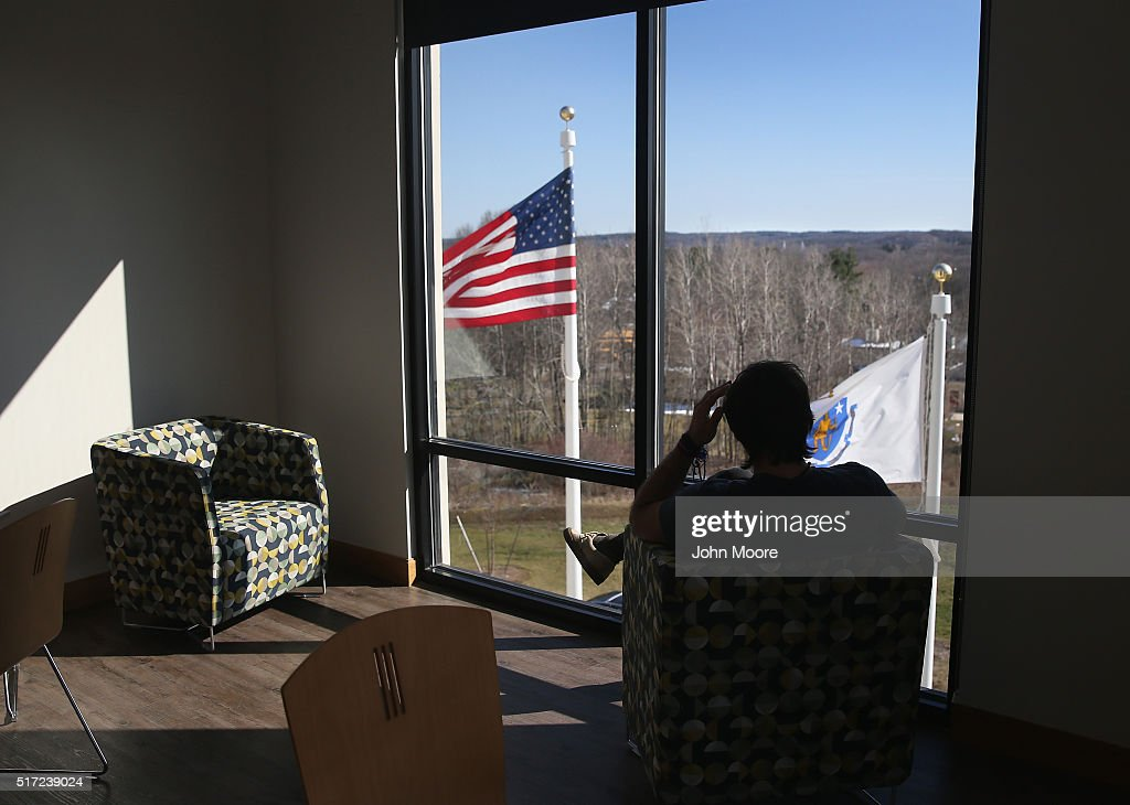 A drug addict in recovery looks out from a substance abuse treatment center on March 22, 2016 in Westborough, MA. The new 100-bed residential rehab center, run by Spectrum Health Systems, is expanding staff, as communities across New England are struggling with the unprecidented heroin and opioid pain pill epidemic. On March 15, the U.S. Centers for Disease Control (CDC), announced guidelines for doctors to reduce the amount of opioid painkillers prescribed nationwide, in an effort to curb the epidemic. The CDC estimates that most new heroin addicts first became hooked on prescription pain medication before graduating to heroin, which is stronger and cheaper.