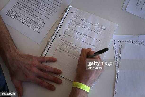 A drug addict in recovery writes a list of motivational quotes at a substance abuse treatment center on March 22 2016 in Westborough MA The new...
