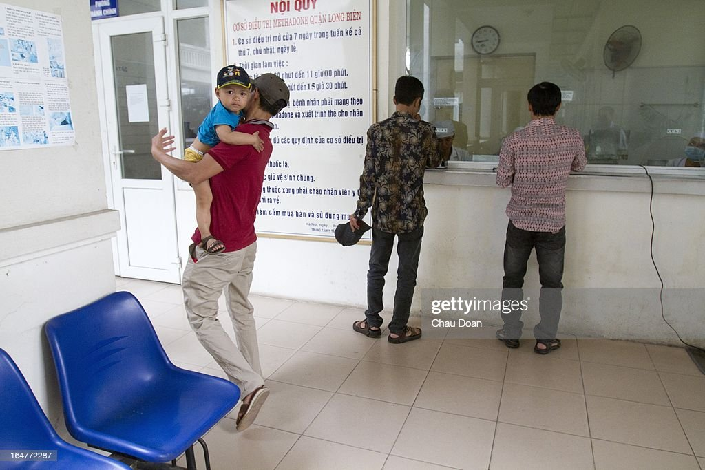 A drug addict leaves with his son after getting his daily methadone dose at the Long Bien District Health Center. Vietnam has many comprehensive health programs aimed at the prevention of HIV and to help drug addicts. At this health center, there are comprehensive HIV services, including HIV testing, antiretroviral treatment, distribution of clean needles and condoms, and methadone maintenance therapy for drug addicts..