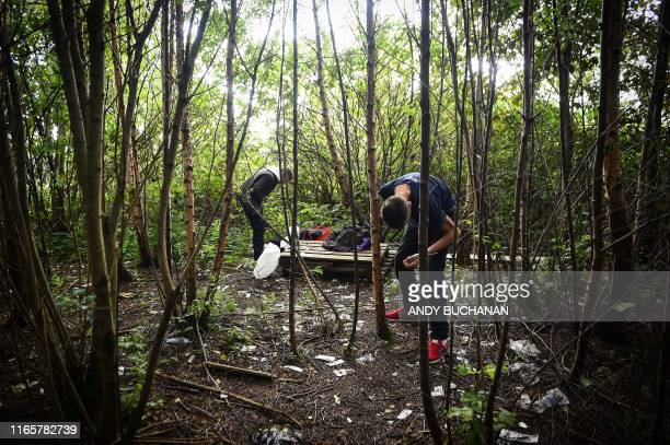 TOPSHOT Drug addict Michael is seen preparing to inject cocaine in a small wooded area used by addicts to take drugs near Glasgow city centre...