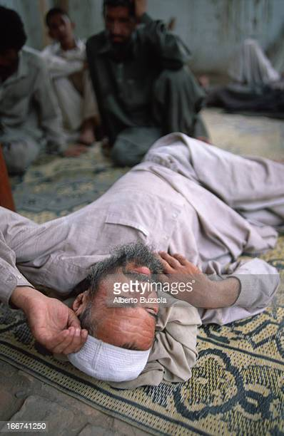 A drug addict resting at the Hayatabad rehabilitation centre