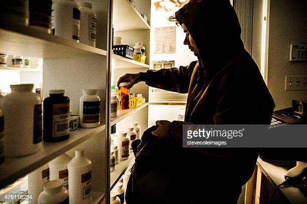 drug addict stealing prescriptions. - armed robbery stock photos and pictures