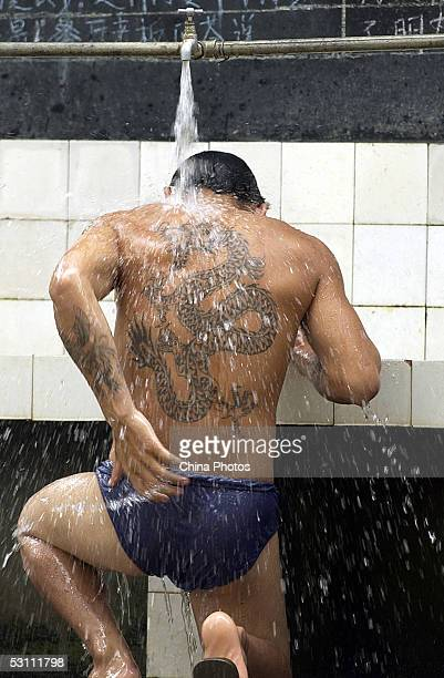 A drug addict takes a shower at the Mangshi Compulsory Drug Rehabilitation Center June 20 2005 in Mangshi Yunnan Province China There are over 900...