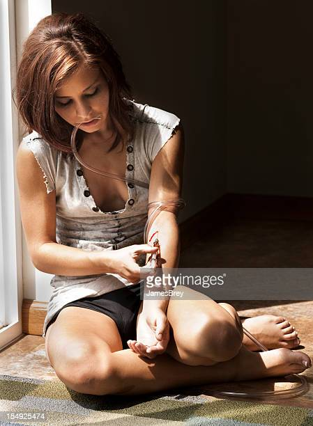 drug addicted girl strung-out with syringe, shooting-up - shooting up stock pictures, royalty-free photos & images