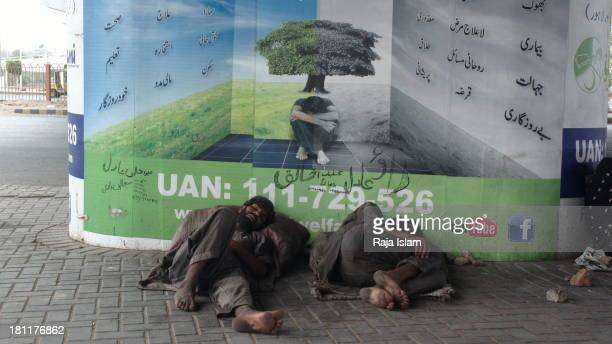 Drug addicts are sleeping near a marketing board which is of a Non-for-profit organization and says they can help poor.