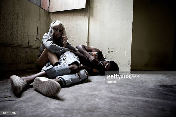 drug addicts finding solace in their vice - heroin stock pictures, royalty-free photos & images