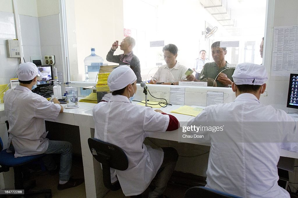 Drug addicts get their daily methadone doses at the Long Bien District Health Center. Vietnam has many comprehensive health programs aimed at the prevention of HIV and to help drug addicts. At this health center, there are comprehensive HIV services, including HIV testing, antiretroviral treatment, distribution of clean needles and condoms, and methadone maintenance therapy for drug addicts..