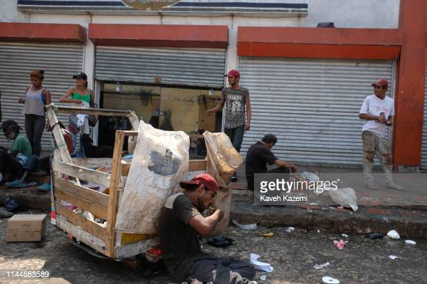 BARRANQUILLA COLOMBIA FEBRUARY 5 2019 Drug addicts hang around and smoke crack cocaine in the old market place on February 5 2019 in Barranquilla...