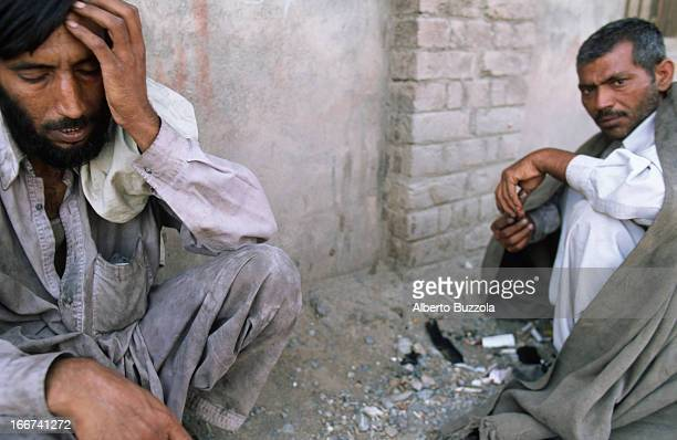 Drug addicts on a street of Peshawar showing withdrawal symptoms