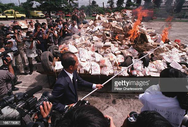 Drug burn A senior Thai politician sets alight a vast pile of confiscated drugs This narcotics pyre contains heroin marijuana amphetamines and many...