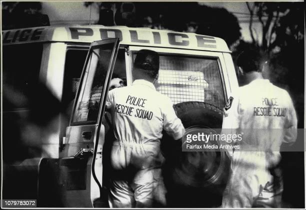 Drug Bust Police load up a police 4WD with evidence of the drug making lab September 14 1991