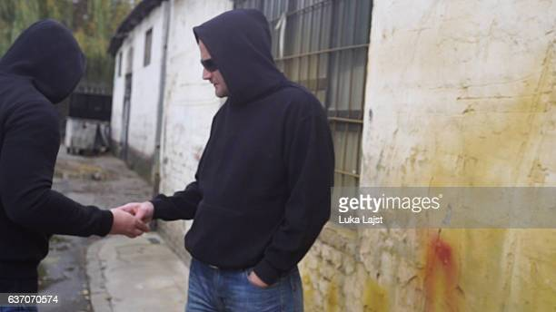 drug dealer selling portions of heroine - marijuana money stock photos and pictures