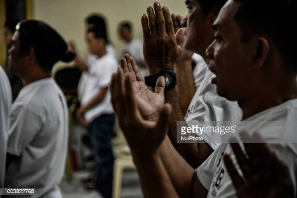 Drug dependents chant worship songs during a community church rehab session in Manila Philippines March 14 2018 More than 27000 have been killed as a...