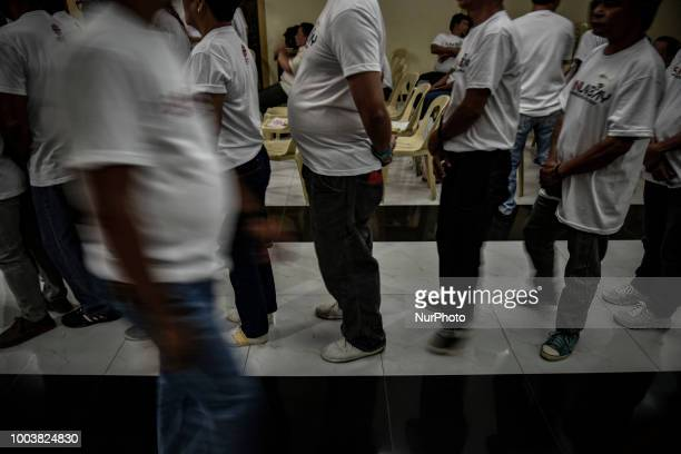 Drug dependents fall in line for communion during a community church rehab session in Manila Philippines March 14 2018 More than 27000 have been...