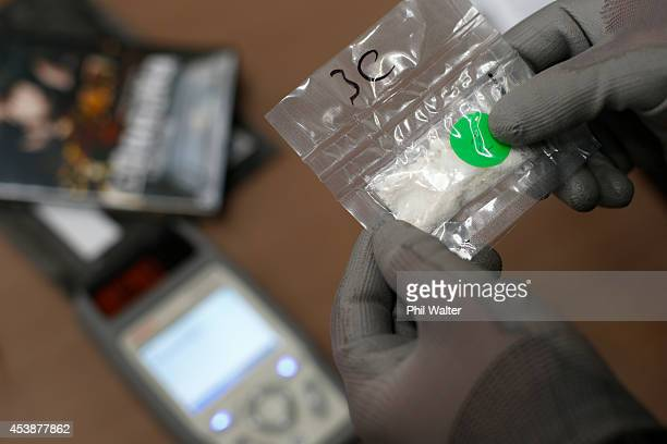 Drug detection equipment, cocaine and seized packages are pictured at the Auckland Airport Customs Air Cargo Inspection Facility on August 21, 2014...
