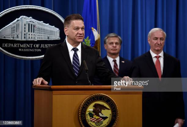 Drug Enforcement acting Administrator Timothy Shea speaks as FBI Director Christopher Wray and Deputy Attorney General Jeffrey A Rosen look on at a...