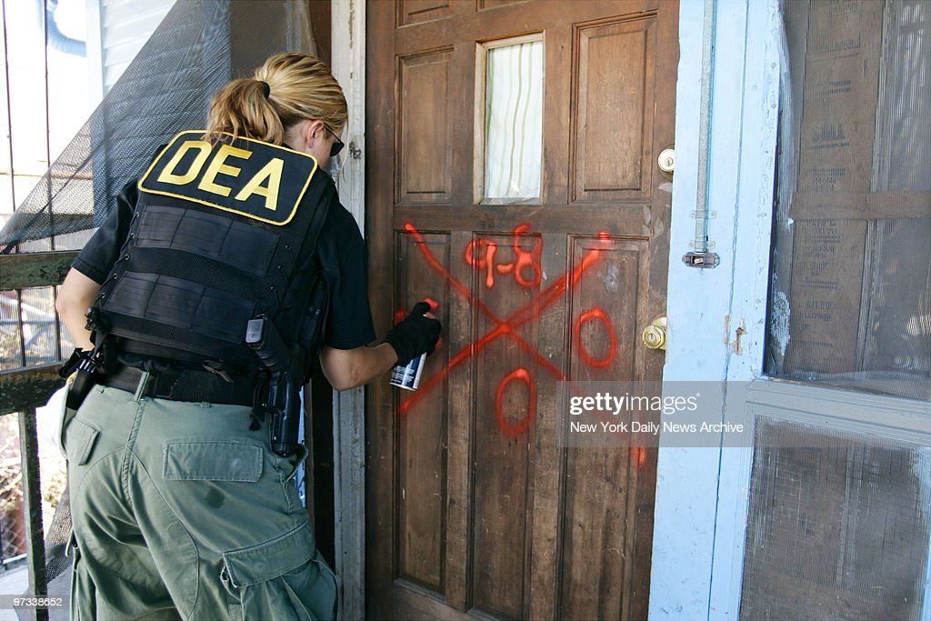 Drug Enforcement Administration agent marks the door of a home in the Lower Ninth Ward of & The Ninth Door Stock Photos and Pictures | Getty Images