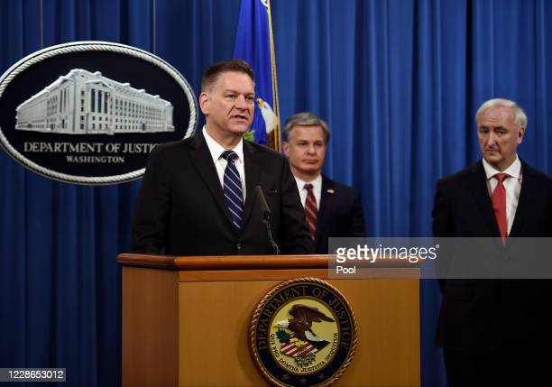 S Drug Enforcment Agency acting Administrator Timothy Shea speaks as FBI Director Christopher Wray and Deputy Attorney General Jeffrey A Rosen look...