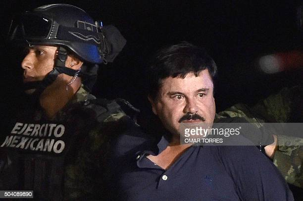 Drug kingpin Joaquin El Chapo Guzman is escorted into a helicopter at Mexico City's airport on January 8 2016 following his recapture during an...