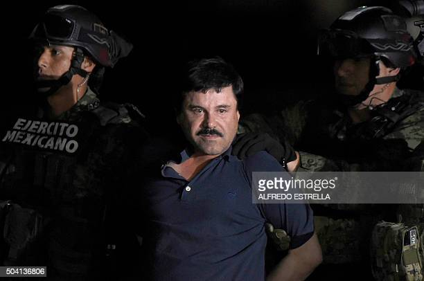 TOPSHOT Drug kingpin Joaquin 'El Chapo' Guzman is escorted into a helicopter at Mexico City's airport on January 8 2016 following his recapture...
